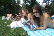 Topless sunbathers read pulp fiction, fight for equality