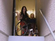 Tiphany and Mia face off against the stairwell in Tiphany's new building.