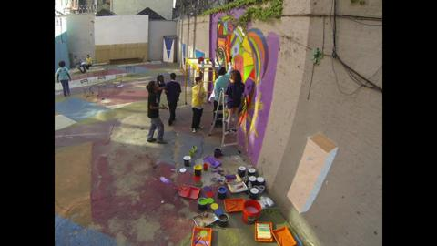 Muralist Don Rimx gets hands-on to teach the DREAM SCHOOL: NYC students a passion for painting.
