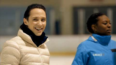 Olympian Johnny Weir shows the students his expert ice skating moves and thanks them for their willingness to go outside their comfort zone.