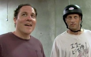 Jon Favreau checks out Tony Hawk's indoor skate ramp.