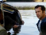 Hap and Leonard discover Illium's van (and Illium) in the pond.