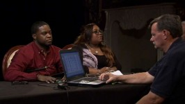 Clive takes a lie detector test with Tanisha setting next to him.