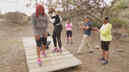 In this deleted scene, the sisters attempt a balancing activity while at the retreat.