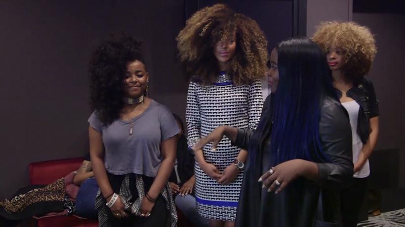 Kim presents some wigs to Leela James.