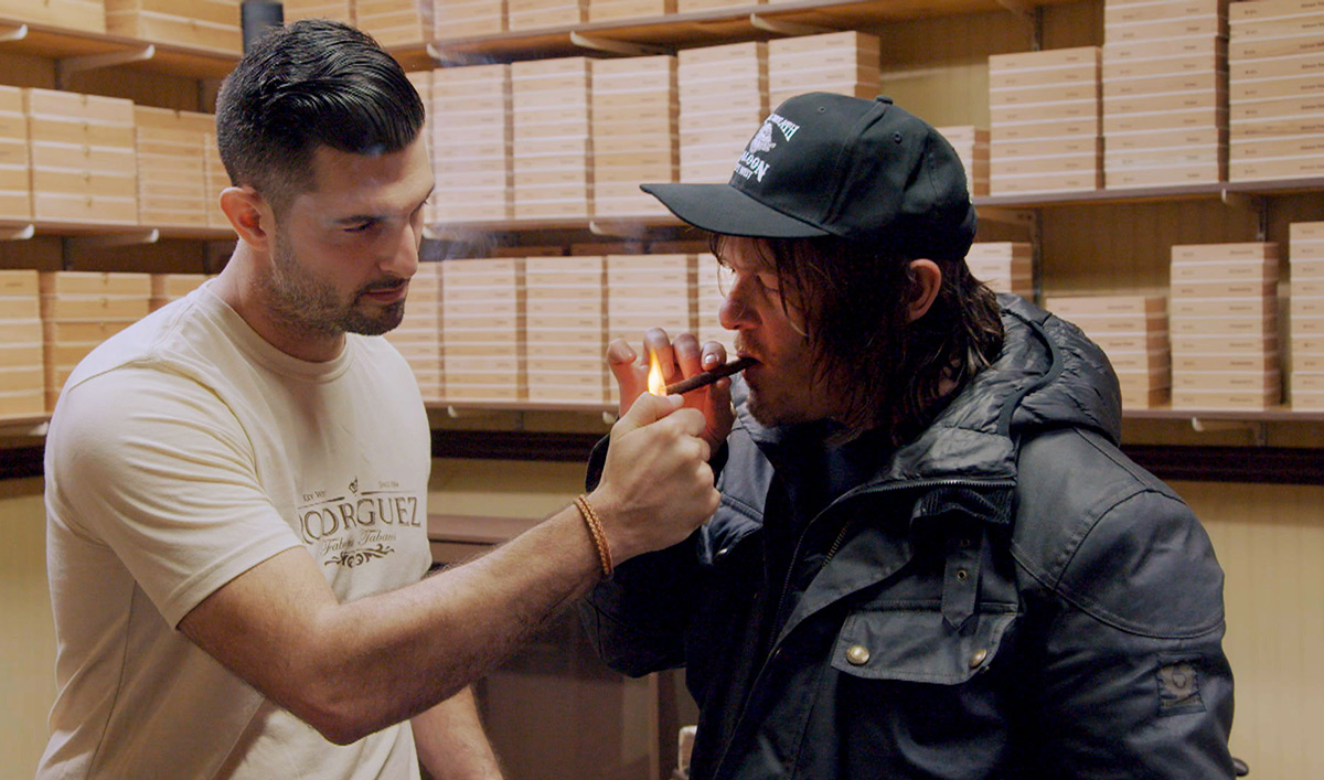 Norman Pushes Up His Sleeves to Try Rolling Cigars by Hand
