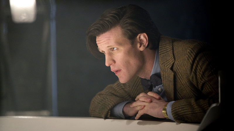 The Doctor (Matt Smith) folds his hands together.