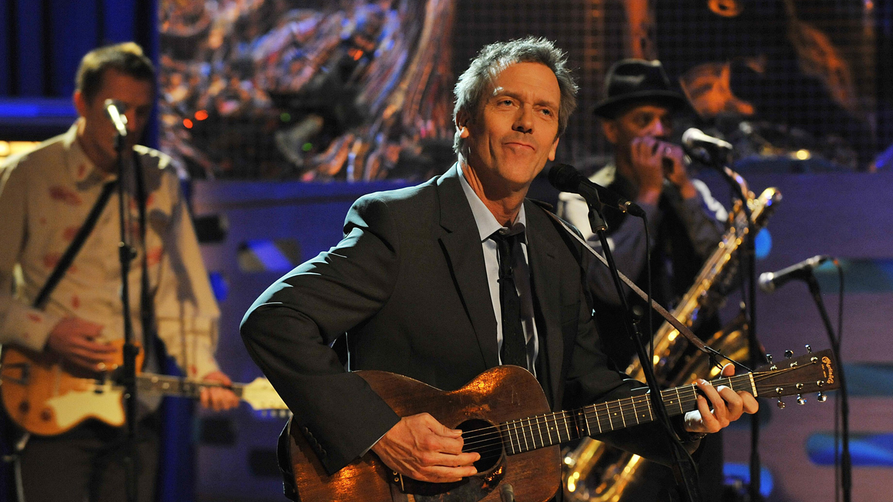 Hugh Laurie performs with his band during episode 2.