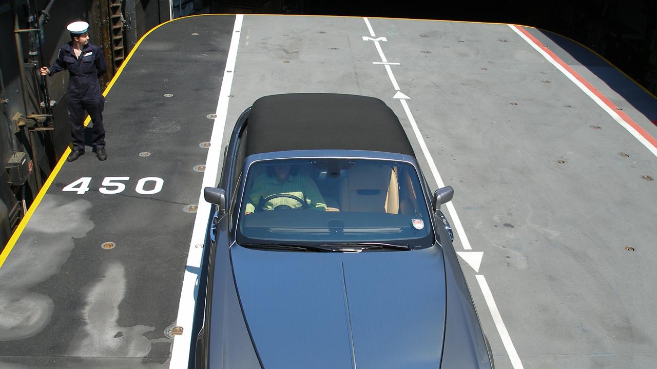 James sits in the Rolls-Royce Phantom Drophead.