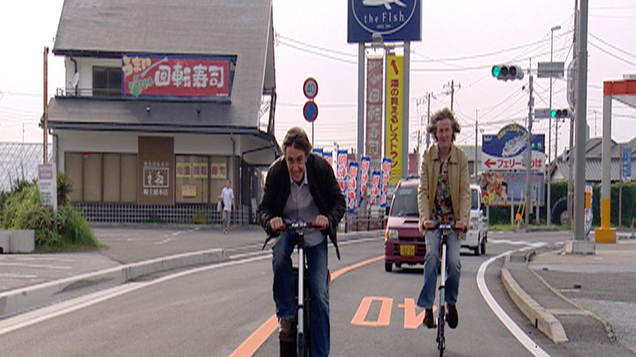 Richard and James ride bikes