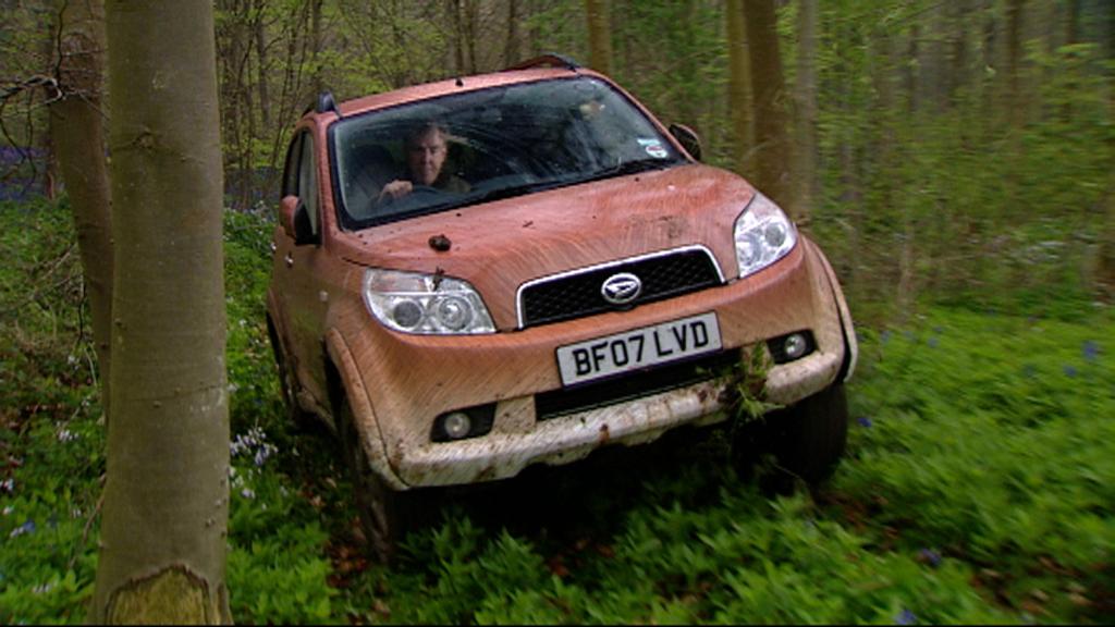 Jeremy drives through a patch of hyacinths