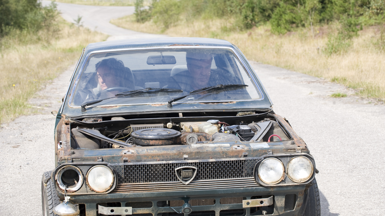 Jeremy and Richard sit in a broken down Lancia