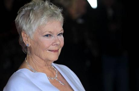 Judi Dench arrives at the world premiere of Skyfall at the Royal Albert Hall.  (Photo by Joel Ryan/Invision/AP)