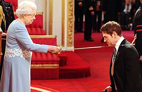 Kenneth Branagh is knighted by the Queen