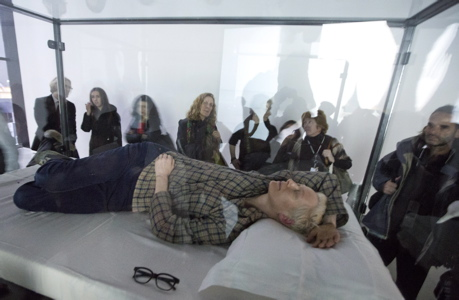 Tilda Swinton sleeping in the performance art piece 'The Maybe' at New York's Museum of Modern Art this morning. (Richard Drew/AP Images)