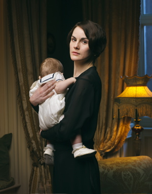 First season four photo - Michelle Dockery, as Lady Mary, holding Downton's youngest resident. (Nick Briggs/Carnival Film and Television Limited 2013 for MASTERPIECE)
