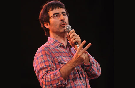 John Oliver flicking the Vs at authority. (AP Images)