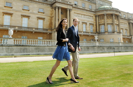 On April 30, the day after the wedding, Will and Kate take a walk on Buckingham Palace grounds. (AP)