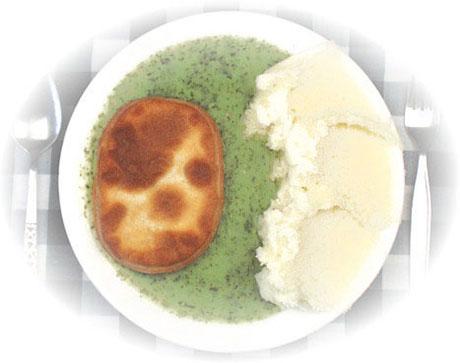 Pie and mash, and yes, that green stuff is liquor.