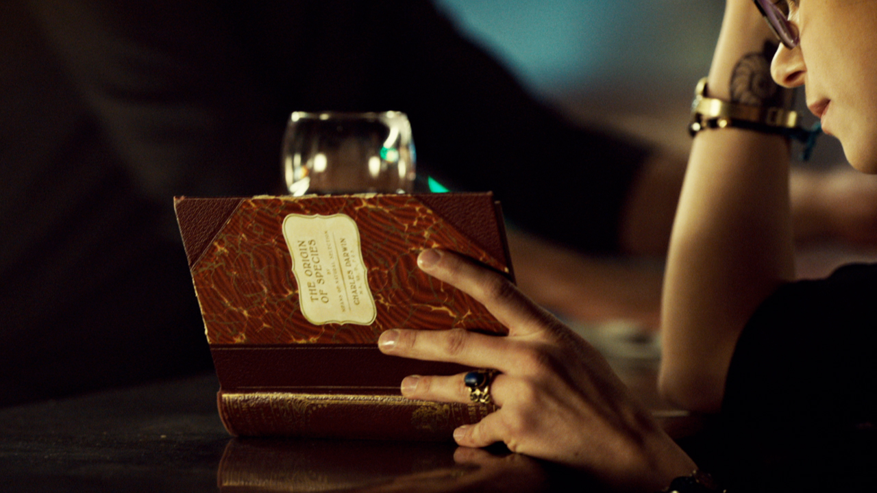 "Cosima reads Darwin's ""The Origins of Species."""
