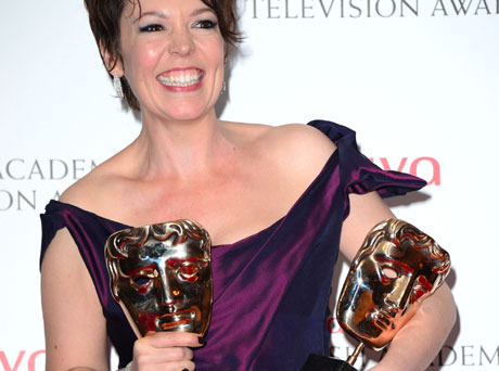 Olivia Colman and her two BAFTAs (Photo by Jon Furniss/Invision/AP)