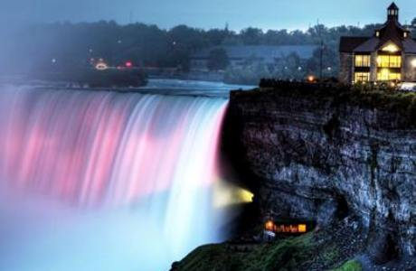 Niagara Falls cast in blue and pink lights. (Photo via the Niagara Falls Facebook Page)