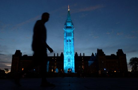 The Peace tower and Parliament buildings in Ottawa, Ontario are illuminated in royal blue to celebrate the birth of the royal baby on Monday July 22, 2013. (AP Photo/The Canadian Press, Adrian Wyld)