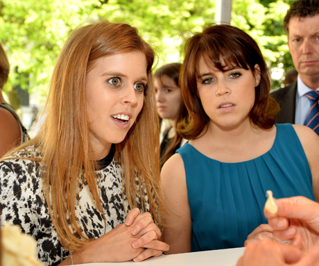 Princesses Beatrice (left) and Eugenie watch as marzipan is made at the Coronation Festival. (Photo: Press Association via AP Images)