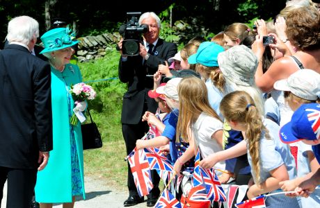Queen Elizabeth II talks to school children from Wiggonby Church of England School as she arrives in Brockhole, Windermere, Cumbria. (Press Association via AP Images)