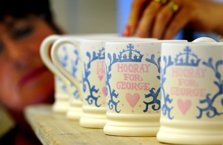 Prince George mugs go into production. Sponge decorator Lynn Lovatt puts the finishing touches to a batch of commemorative Royal Baby mugs for Prince George of Cambridge, as they go into production at the Emma Bridgewater Factory, Stoke On Trent. Picture date: Thursday July 25, 2013. The half pint mug in creal earthenware is hand decorated in the company's signature sponged technique. Its lavender blue curls and swirls frame that all important name as well as the birth date of Prince George. See PA story ROYAL Baby Pottery. Photo credit should read: Rui Vieira/PA Wire URN:17147849 (Press Association via AP Images)