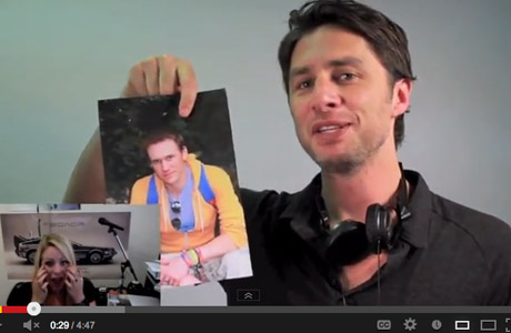 Zach Braff holds a picture of Matt Hulbert and that's his gf in the left corner. (Screen Shot)