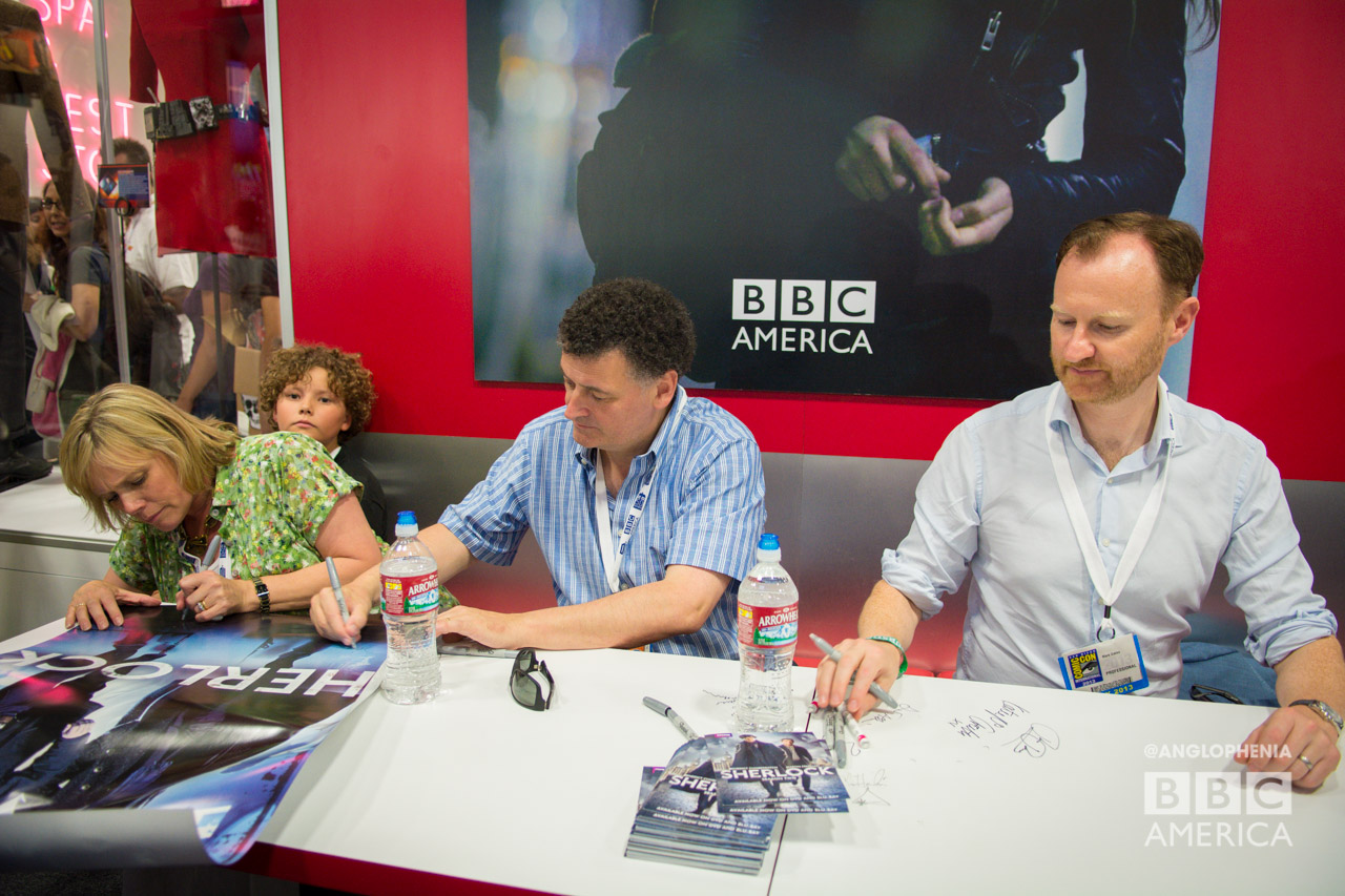 Sue Vertue, Steven Moffat, and Mark Gatiss signing for fans at the BBC AMERICA booth. (Photo: Dave Gustav Anderson)