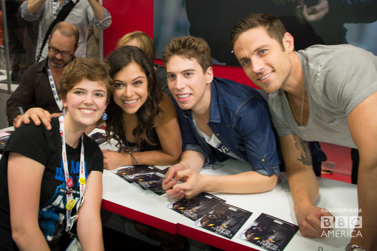 The 'Orphan Black' cast pose with a fan. (Photo: Dave Gustav Anderson)