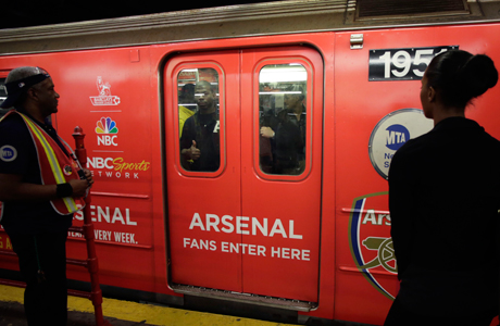 A New York subway train wrapped in Arsenal ads, part of NBC Sports' huge marketing campaign to draw attention to their coverage of Premier League football. (Photo: AP/Mark Lennihan)