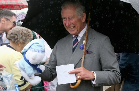 Royal visit to the Sandringham Flower Show. The Prince of Wales is presented with a teddy bear for Prince George of Cambridge during a visit to the 132nd Sandringham Flower Show at Sandringham House in Norfolk. Picture date: Wednesday July 31, 2013. See PA story ROYAL Charles. Photo credit should read: Chris Jackson/PA Wire URN:17202086 (Press Association via AP Images)