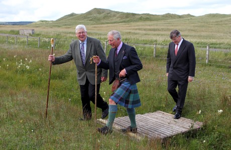 Prince of Wales visit to Greenland Meadow. The Prince of Wales walks alongside Hamish Pottinger (left) the owner of Greenland Meadow, during a visit to the meadow located near Dunnet Bay, a two-mile beach on the northern coastline, which is home to rare plants and the most northerly population of bumblebees and blue butterflies. Picture date: Monday August 5, 2013. See PA story ROYAL Charles. Photo credit should read: Andrew Milligan /PA Wire URN:17244088 (Press Association via AP Images)