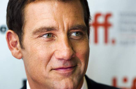 "British actor Clive Owen arrives on the red carpet for the film ""Intruders"" during the 36th Toronto International Film Festival"