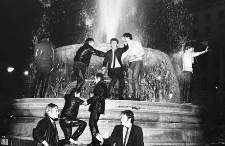 A bunch of mates frollick in the fountain on New Year's Eve, 1968. (AP)