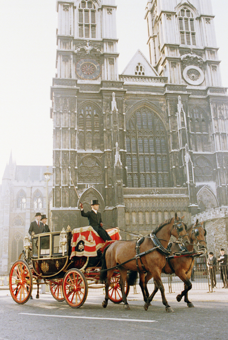 An ordinary landau takes the place of the Glass Coach in front of London's Westminster Abbey on July 17, 1986 during a rehearsal for the July 23 wedding of Prince Andrew and Sarah Ferguson. The full rehearsal took place shortly after dawn, with only the bride, groom and members of the Royal family plus the Gold Coach, which is never used for rehearsals, missing. (AP Photo/Gerald Penny)