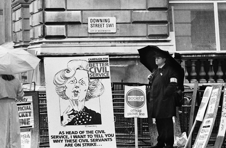 Alone picket at the entrance to London?s Downing Street on June 8, 1987, the official London residence of the Prime Minister, represents the nations civil service union, the Society of Civil and Public Servants, who are on a 24-hour strike on Monday for better pay. (AP Photo/Peter Kemp)