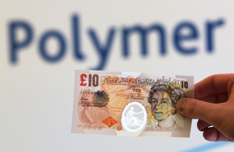 A sample Polymer ten pound banknote is shown during the news conference at the Bank of England in London during a consultation on plans to issue plastic bank notes within the next three years. (AP)