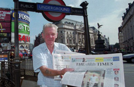 Free copies of The Times is passed out in front of the London Underground. (AP)