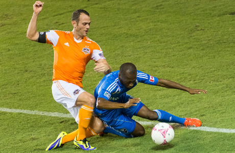 Houston Dynamo midfielder Brad Davis, left, collides with Montreal Impact midfielder Sanna Nyassi during the second half of an MLS soccer match Friday, Oct. 4, 2013, in Houston. (Photo: AP/Houston Chronicle, Smiley N. Pool)