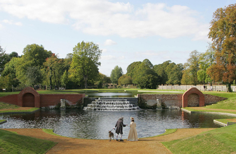 Actors in 18th century period costumes walk around the newly restored Upper Lodge Water Gardens in Bushy Park. (AP)