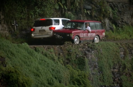 """Jeremy Clarkson (in the red car) navigates the Bolivian """"road of death."""" (BBC)"""