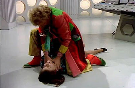 The Sixth Doctor strangles Peri