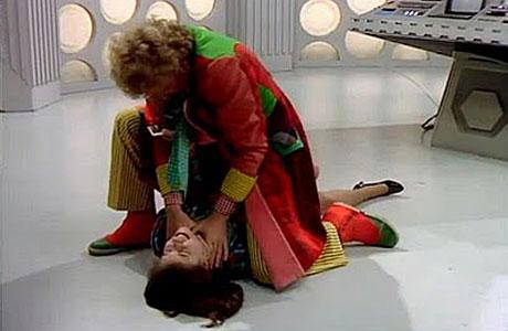 The Sixth Doctor strangles Peri