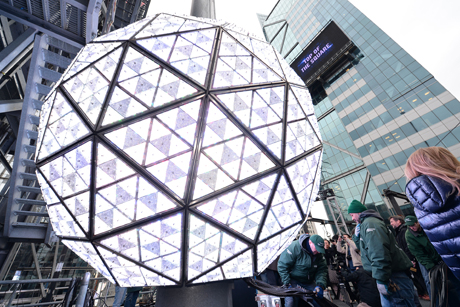The Waterford Crystal ball will drop in Times Square in NYC at midnight tonight. (Anthony Behar/Sipa/AP Photos)