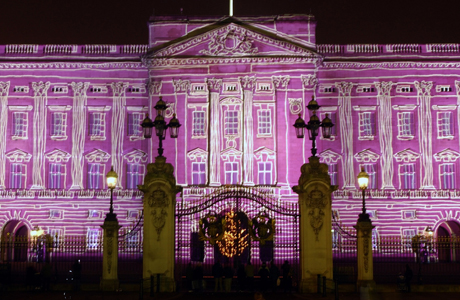 Buckingham Palace, seen illuminated by a projection at the start of New Year's Eve celebrations, in central London, before midnight, Wednesday, Dec. 31, 2003. (AP Photo/Adam Butler)