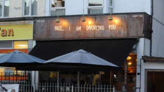 Woman announces plans to divorce cheating husband using bar sign
